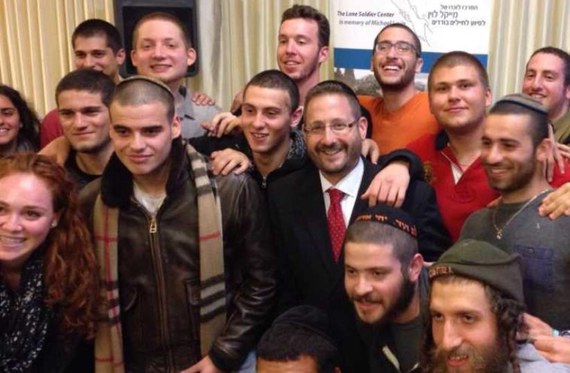 Former MK Dov Lipman with lone soldiers at a Thanksgiving dinner arranged by the Lone Soldier Center. (photo credit: DOV LIPMAN)
