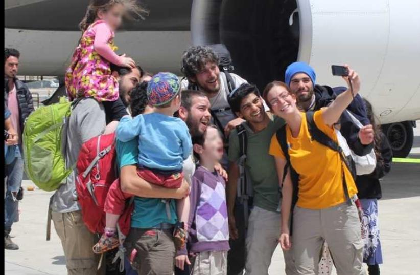 Israelis greet family members upon return from Nepal at Ben-Gurion Airport (photo credit: BEN HARTMAN)