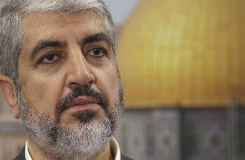 Hamas leader Khaled Mashaal speaks during an interview with Reuters in Doha (photo credit: REUTERS)