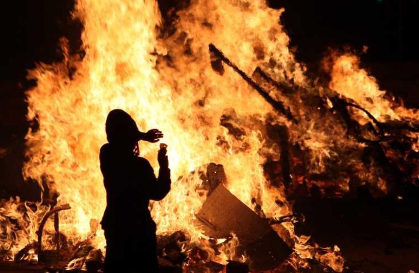 A bonfire seen on Lag Ba'omer (photo credit: MARC ISRAEL SELLEM/THE JERUSALEM POST)