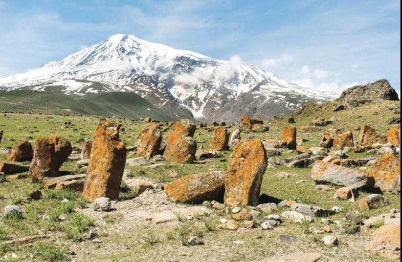 Mount Ararat overlooking a field of eroded khachkars (Armenian cross-stones) in Western Armenia, from the book '100 (1915-2015)'. (photo credit: HRAIR 'HAWK' KHATCHERIAN)