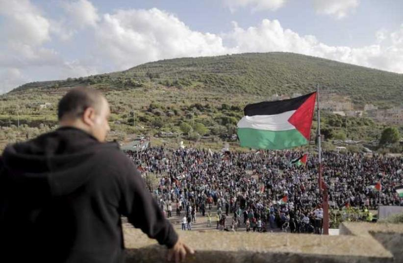 Israeli Arab demonstrators take part in a Land Day rally in the northern village of Deir Hanna (photo credit: REUTERS)