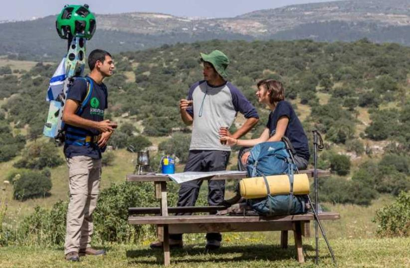 SPNI youth members on Israel's National Trail with Google Street View cameras  (photo credit: SPNI)