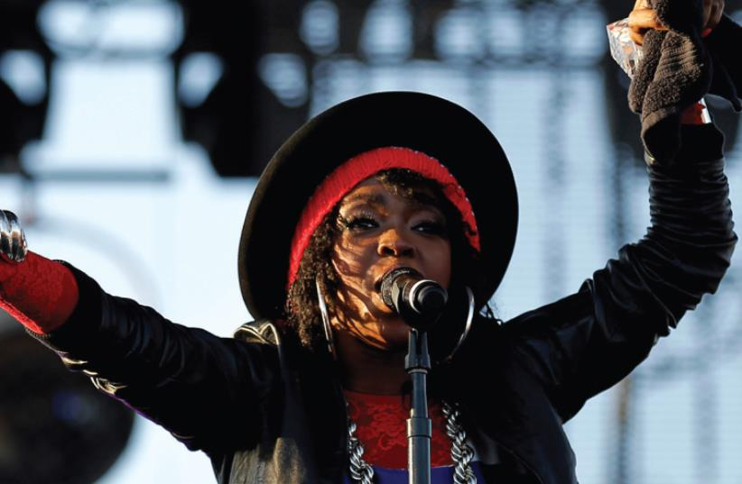 SINGER LAURYN HILL performs at the Coachella Valley Music & Arts Festival California in 2011. BDS activists are pressuring Hill to cancel her upcoming performance in Israel, scheduled for this Thursday. (photo credit: REUTERS)