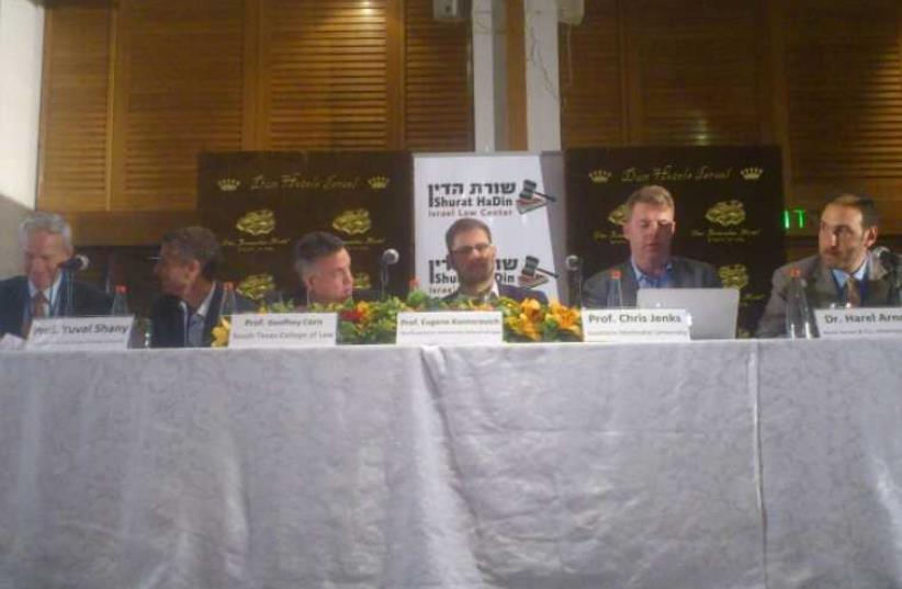 PROF. ROBBIE SABEL (far left) sits with fellow panelists yesterday at the Shurat Hadin conference in Jerusalem (photo credit: YONAH JEREMY BOB)