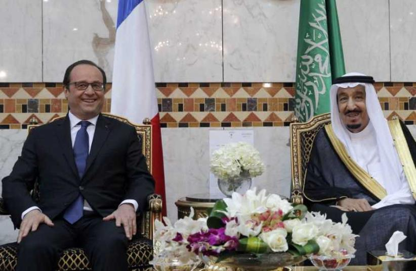 French President Francois Hollande and Saudi King Salman meet to dicuss regions affecting the Middle East  (photo credit: REUTERS)