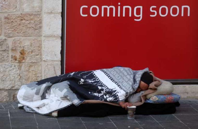 Homeless person on Jaffa Street in Jerusalem. (photo credit: MARC ISRAEL SELLEM/THE JERUSALEM POST)