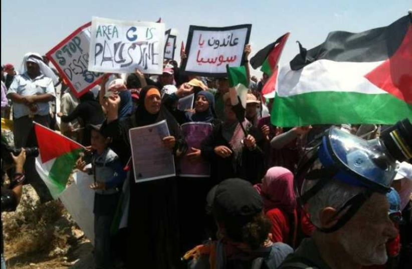 Palestinians demonstrate against the demolition of the village Sussiya by Israel, June 2012 (photo credit: Wikimedia Commons)