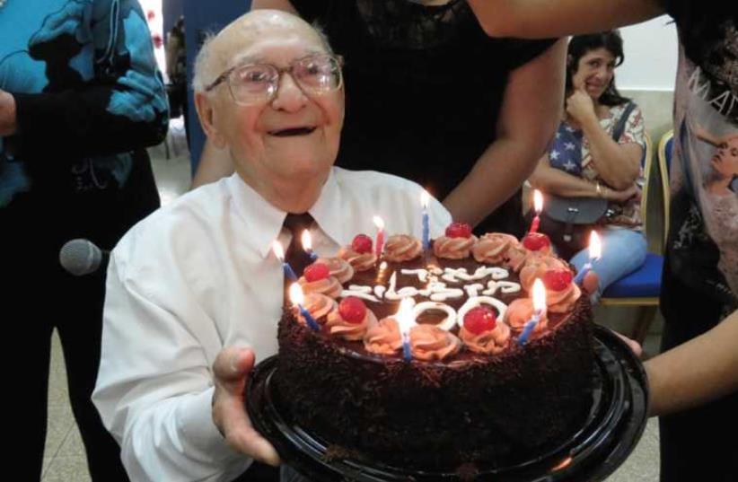 Meir Greenstein with his birthday cake. (photo credit: COURTESY BAT YAM MUNICIPALITY)