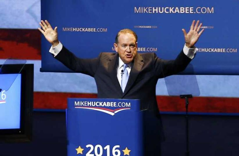 U.S. Republican presidential candidate and former Arkansas Governor Mike Huckabee addresses supporters as he formallly launches his bid for the 2016 Republican presidential nomination during an event in Hope, Arkansas May 5, 2015. (photo credit: REUTERS)