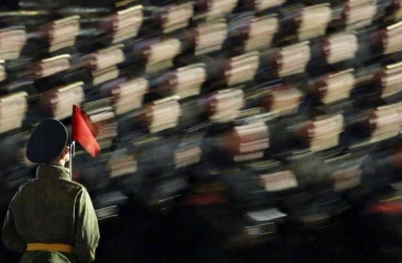 Russian servicemen take part in a rehearsal for the Victory parade on Moscow's Red Square (photo credit: REUTERS)