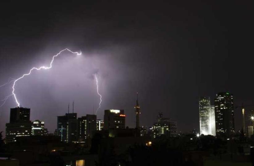 Lightning strikes over the skyline of Tel Aviv during a rain storm (photo credit: REUTERS)
