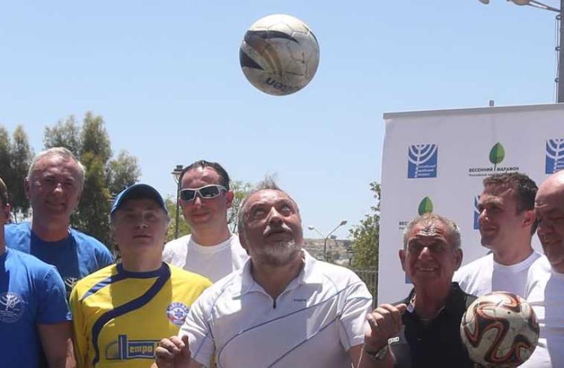 Avigdor Liberman plays soccer (photo credit: MARC ISRAEL SELLEM/THE JERUSALEM POST)