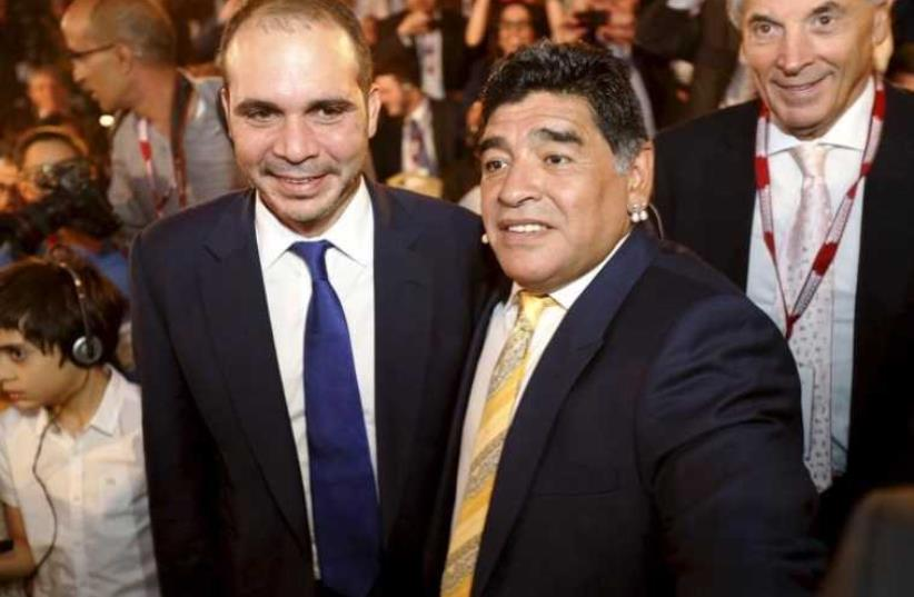 Jordan's Prince Ali Bin Al Hussein (L), FIFA presidential candidate, poses with Argentina's former soccer player Diego Maradona (photo credit: REUTERS)