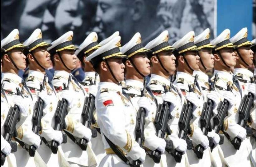 Chinese Army servicemen march during the Victory Day parade at Red Square in Moscow