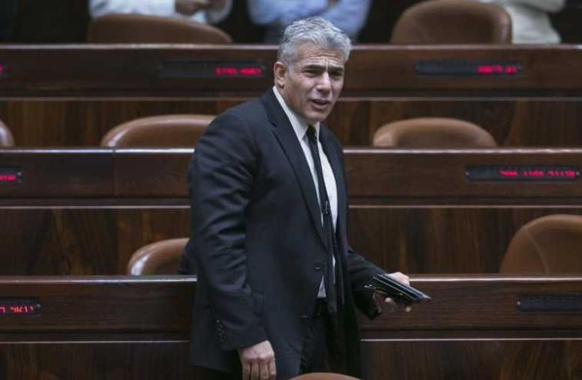 Israel's dismissed Finance Minister Yair Lapid arrives at the Knesset (photo credit: REUTERS)