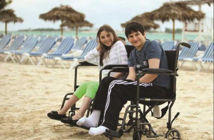 TZVI AND RACHELI Herzfeld enjoy a day at the beach (photo credit: Courtesy)