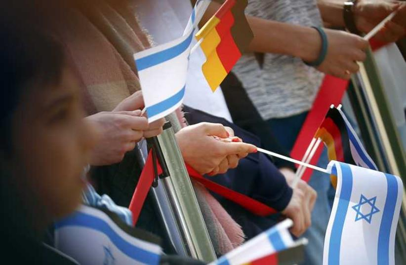 German and Israeli flags  (photo credit: REUTERS)