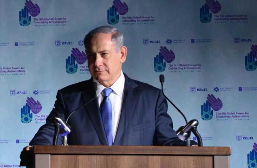Prime Minister Benjamin Netanyahu speeks at the fifth Global Forum for Combating anti-Semitism (photo credit: KOBY GIDEON/GPO)