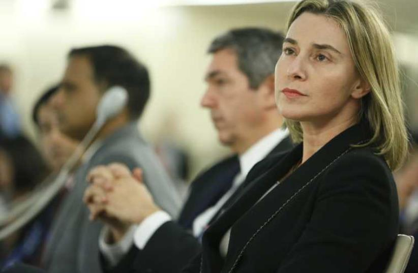 European Union foreign policy chief Federica Mogherini prepares to address the 28th Session of the Human Rights Council at the United Nations in Geneva (photo credit: REUTERS)