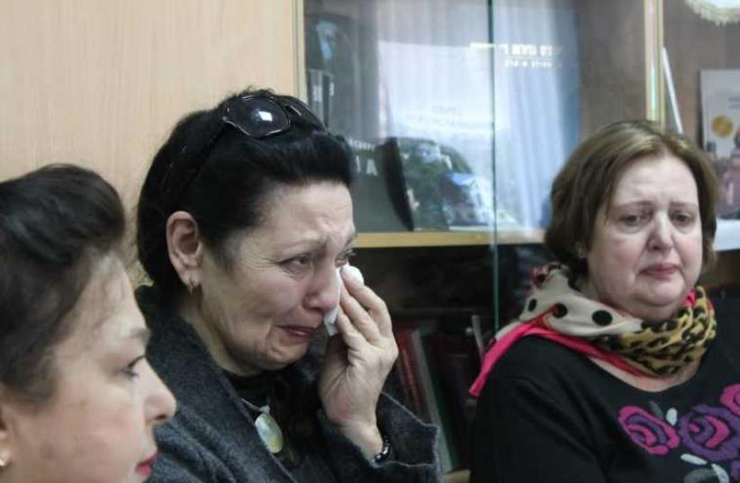 Jewish refugees from eastern ukraine cry as they recount their stories of escape during a gathering in Kiev just before passover. (photo credit: SAM SOKOL)