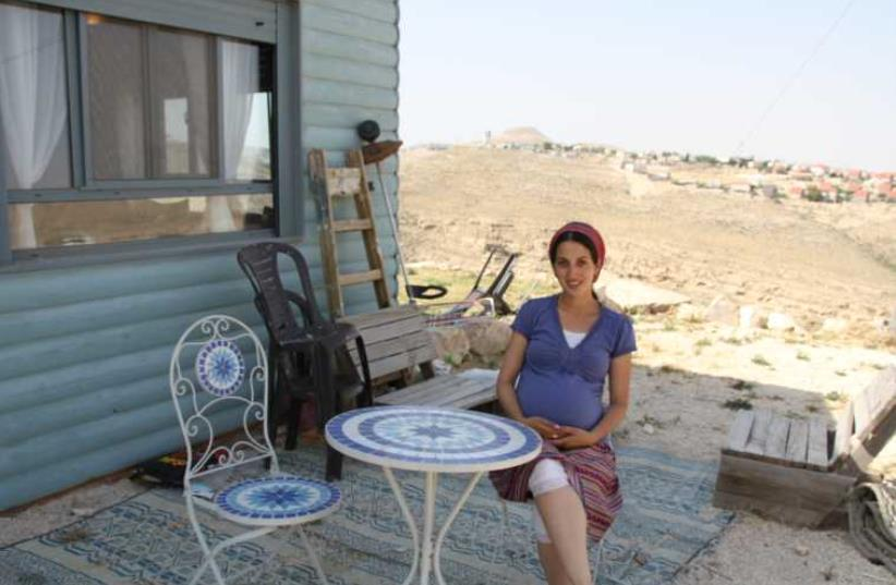 Tehila Makover outside her home in the West Bank outpost of Tekoa D.  (photo credit: TOVAH LAZAROFF)