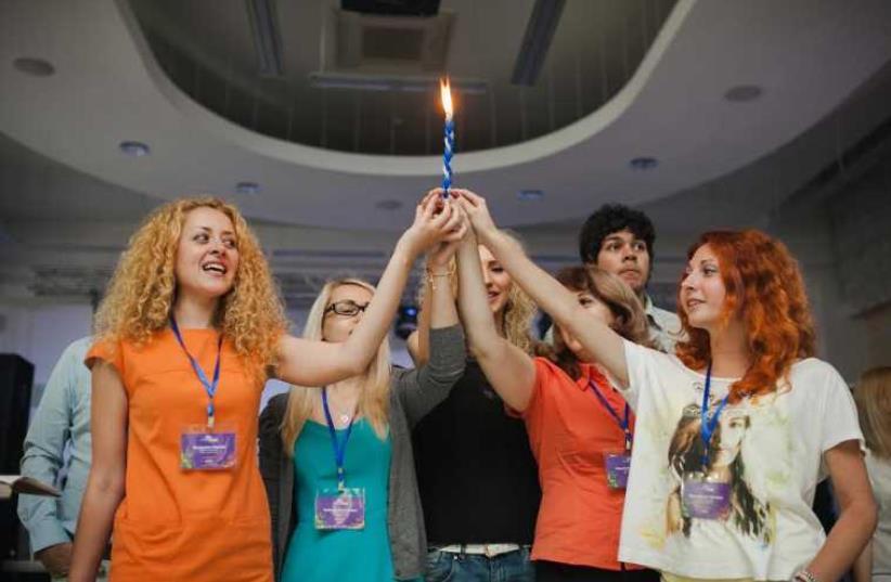 MOLDOVIAN JEWS celebrate Shabbat at Limmud FSU conference last year.  (photo credit: COURTESY LIMMUD FSU)