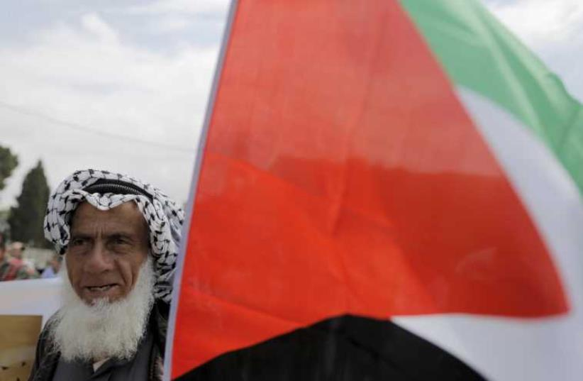 A Palestinian man during a rally ahead of the Nakba day in Bethlehem May 14, 2015. (photo credit: REUTERS)