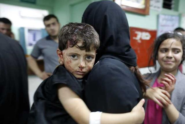 A boy who was injured by an explosion at a Hamas training camp at a hospital in Beit Lahiya, Gaza (photo credit: AFP PHOTO)