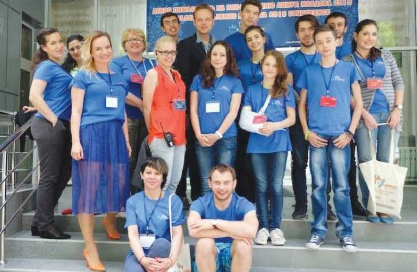 LIMMUD FSU volunteers pose for a picture at the organization's conference in Kishinev, Moldova. (photo credit: COURTESY LIMMUD FSU)