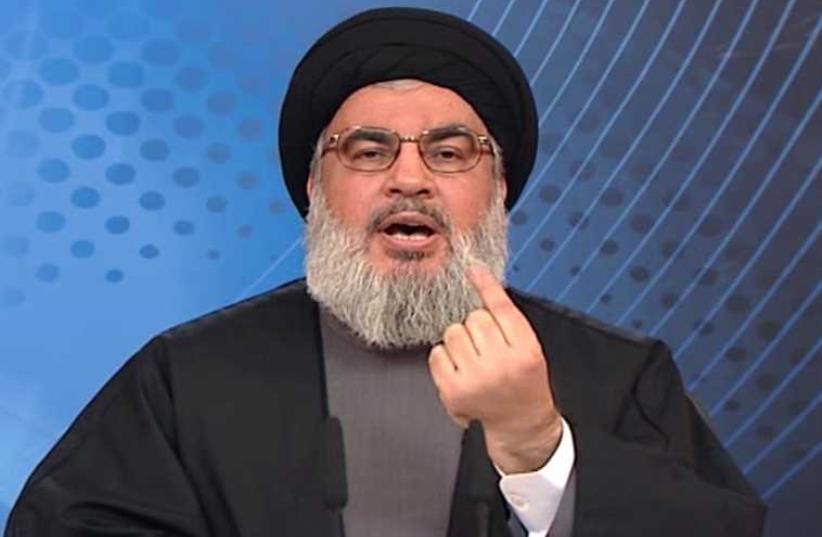 Hassan Nasrallah (photo credit: HO / AL-MANAR TV / AFP)