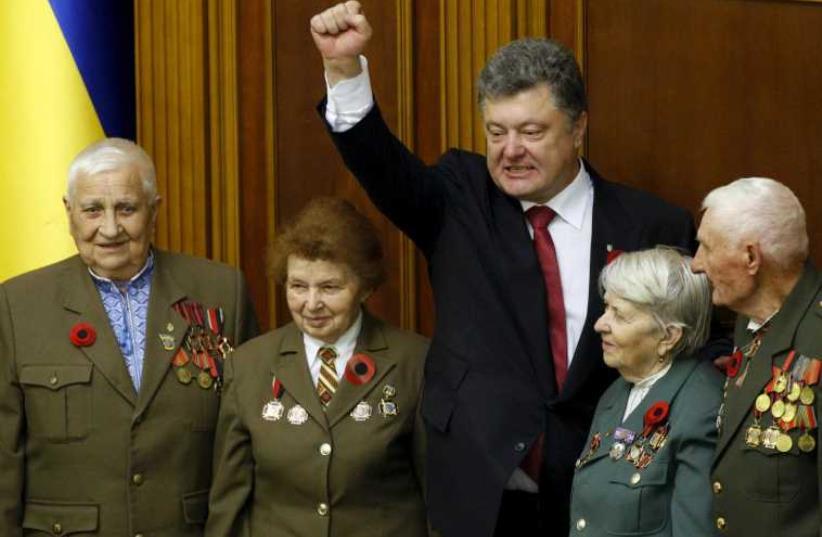 Ukrainian President Petro Poroshenko (C) gestures as he stands with veterans of the Ukrainian insurgent army (UPA) in Kiev, May 8, 2015 (photo credit: REUTERS)
