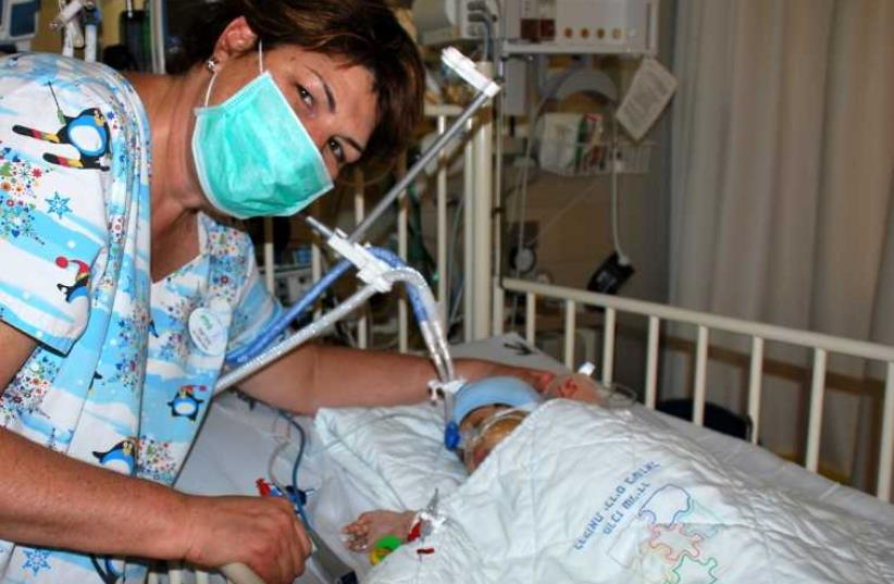 Schneider courtesy photo of baby after transplant surgery.  (photo credit: Courtesy)