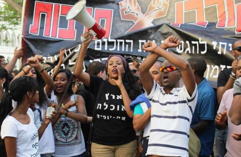 Demonstrators in Tel Aviv gather to protest racism and police brutality, May 18, 2015 (photo credit: BEN HARTMAN)