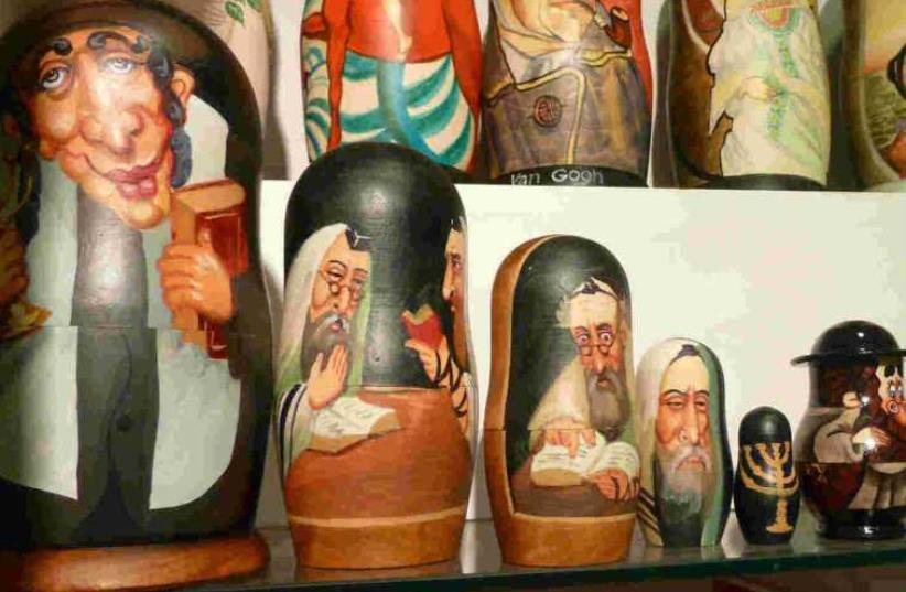 Russian nesting dolls painted with anti-Semitic stereotypes of Jews found in a Moscow hotel gift shop. (photo credit: SIMON WIESENTHAL CENTRE)