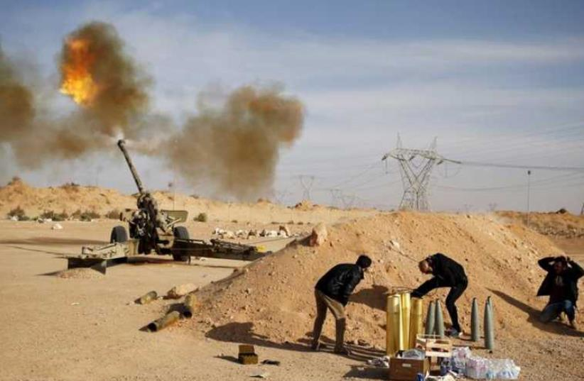 Libya Dawn fighters fire an artillery cannon at IS militants near Sirte. (photo credit: REUTERS)