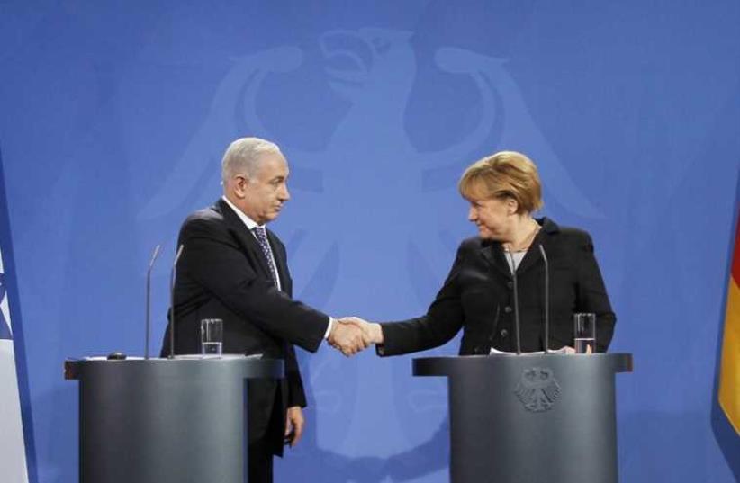 Netanyahu and Merkel (photo credit: WOLFGANG RATTAY / REUTERS)