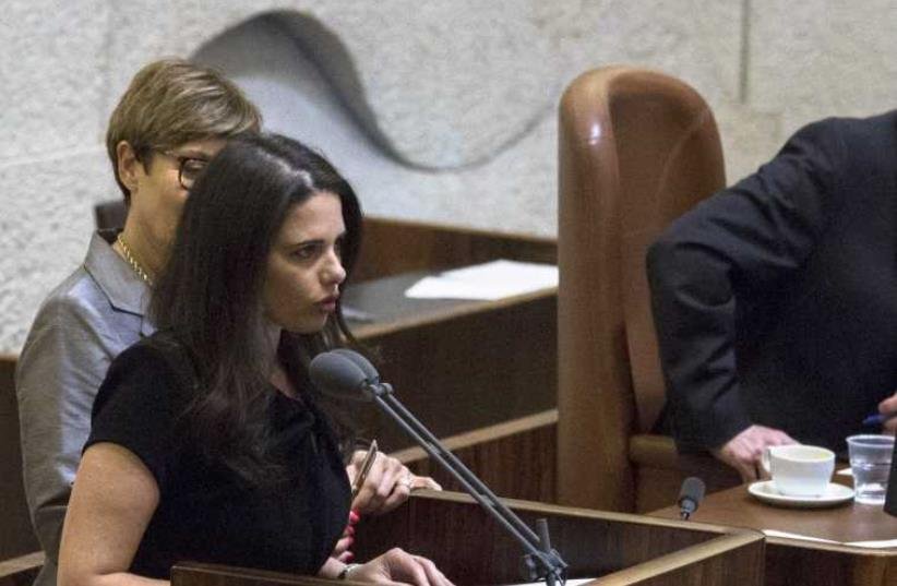 Ayelet Shaked is sworn in as Justice Minister at the Knesset, in Jerusalem, May 14. (photo credit: JIM HOLLANDER / POOL / REUTERS)