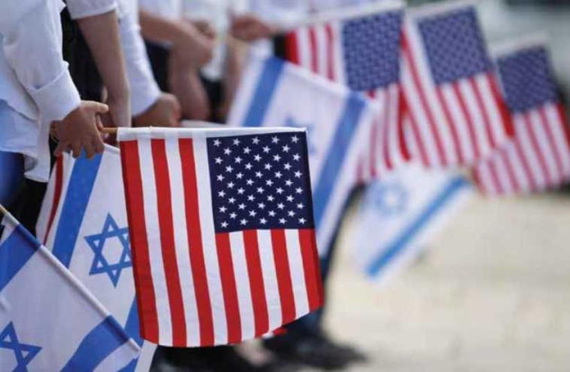 Israel US flags (photo credit: REUTERS)