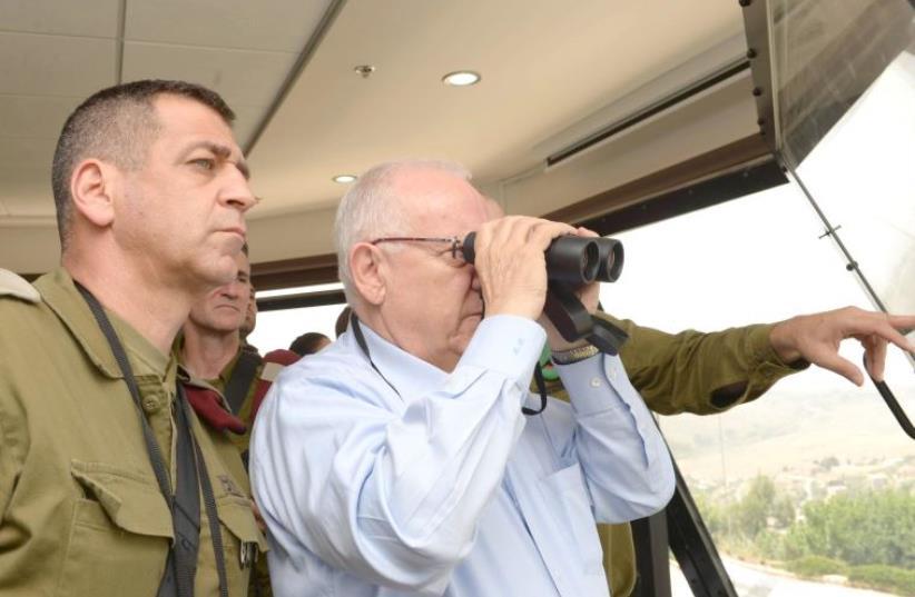 President Reuven Rivlin and OC Northern Command Maj.-Gen. Aviv Kochavi on tour of northern border (photo credit: Mark Neiman/GPO)