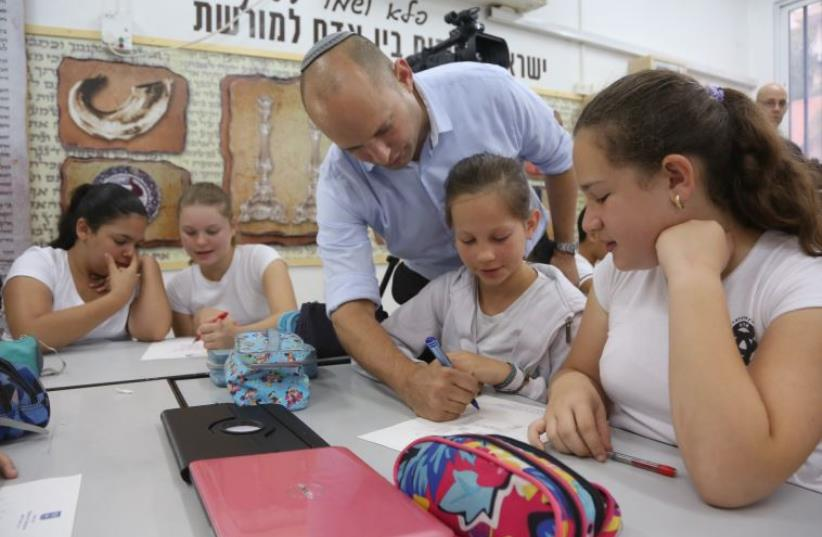 Naftali Bennett teaches math (photo credit: SASSON TIRAM)
