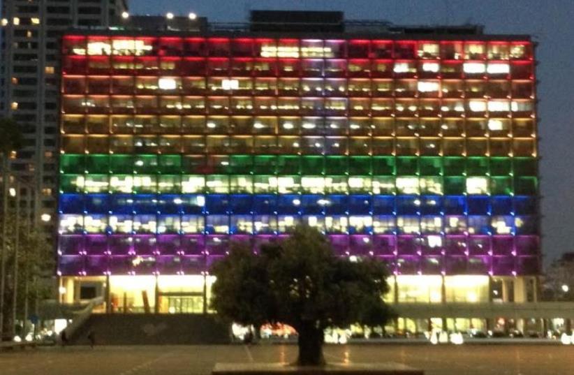 Tel Aviv Municpality building lit up in rainbow colors symbolizing LGBT pride (photo credit: NIV ELIS)