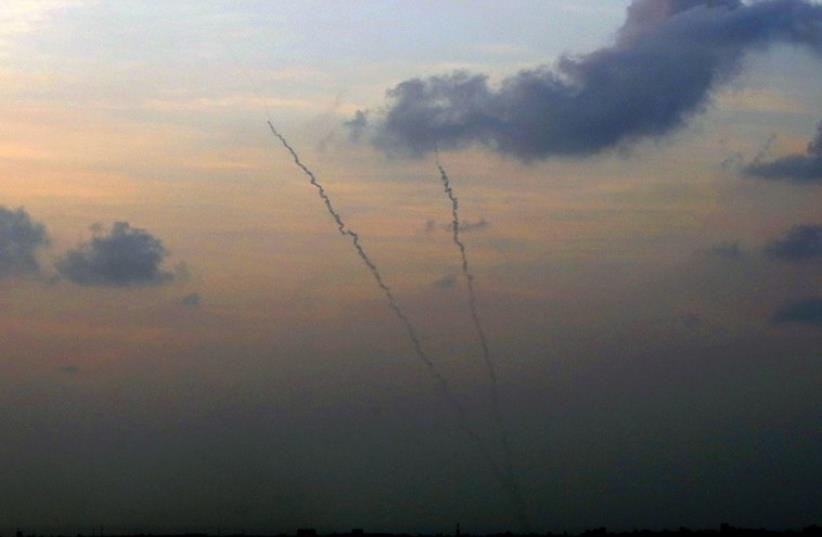 Smoke trails are seen as two rockets are launched from the central Gaza Strip towards Israel (photo credit: REUTERS)