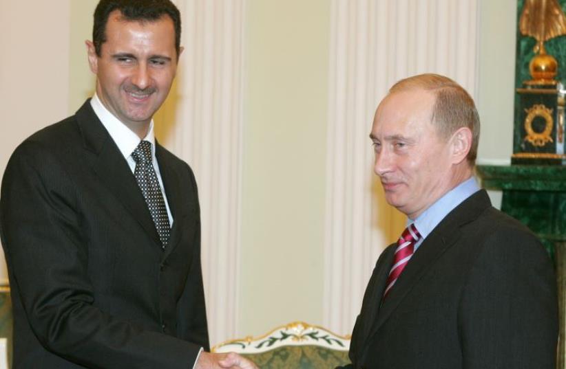 Bashar Assad and Vladimir Putin (photo credit: REUTERS)