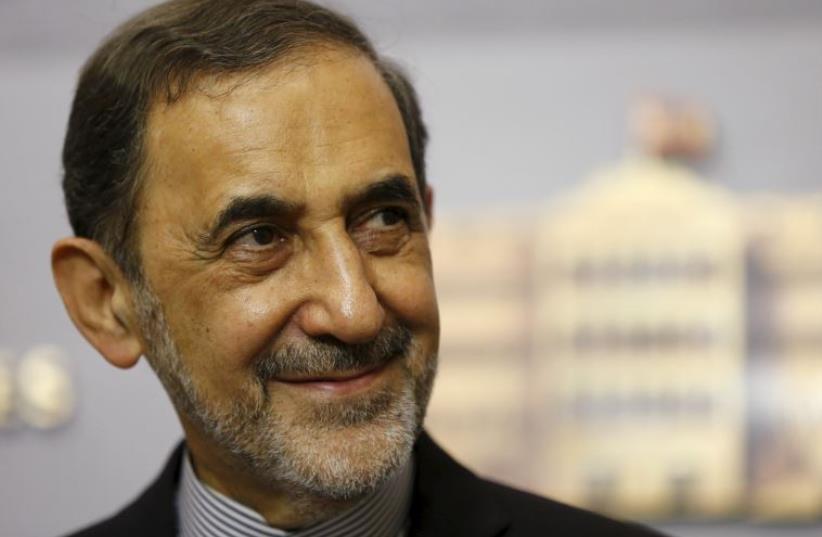 Ali Akbar Velayati, Iran's Supreme Leader Ayatollah Ali Khamenei's top adviser on international affairs, smiles at the government palace in Beirut (photo credit: REUTERS)