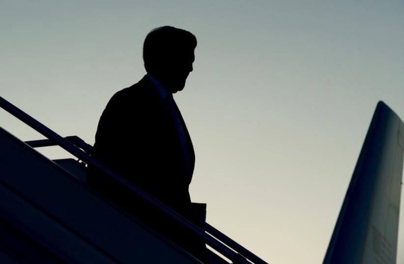 US Secretary of State John Kerry is seen in silhouette as he deplanes against an evening sky after arriving in Geneva, Switzerland, on May 29, 2015 (photo credit: STATE DEPARTMENT PHOTO)