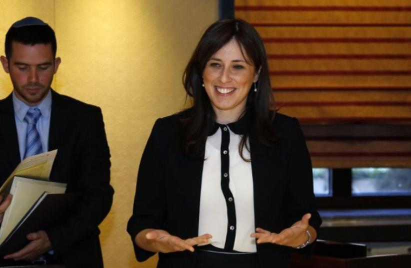 Deputy Foreign Minister Tzipi Hotovely (R) waits for European Union foreign policy chief Federica Mogherini ahead of a meeting at King David Hotel (photo credit: AFP PHOTO / GALI TIBBON)