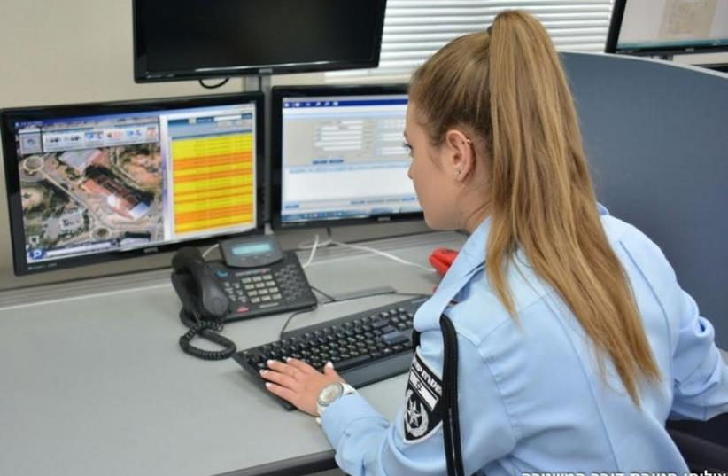 AN ISRAELI police officer mans the new National Police Public Information Call Center in Holon on Monday (photo credit: POLICE SPOKESPERSON'S UNIT)