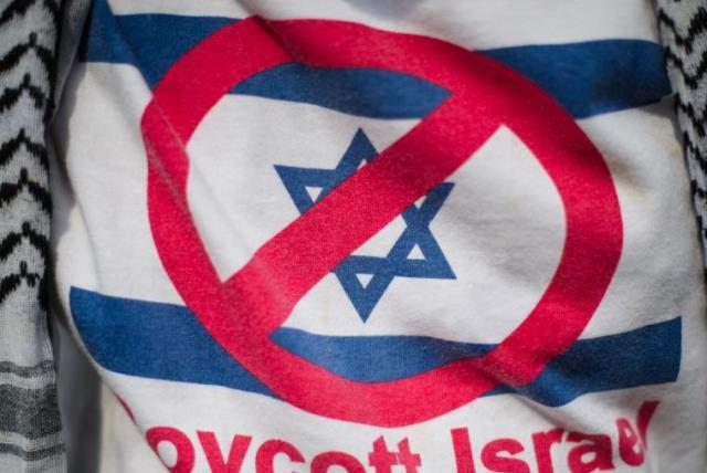 A demonstrator wears a shirt reading 'Boycott Israel' [File] (photo credit: AFP/ MOHD RASFAN)