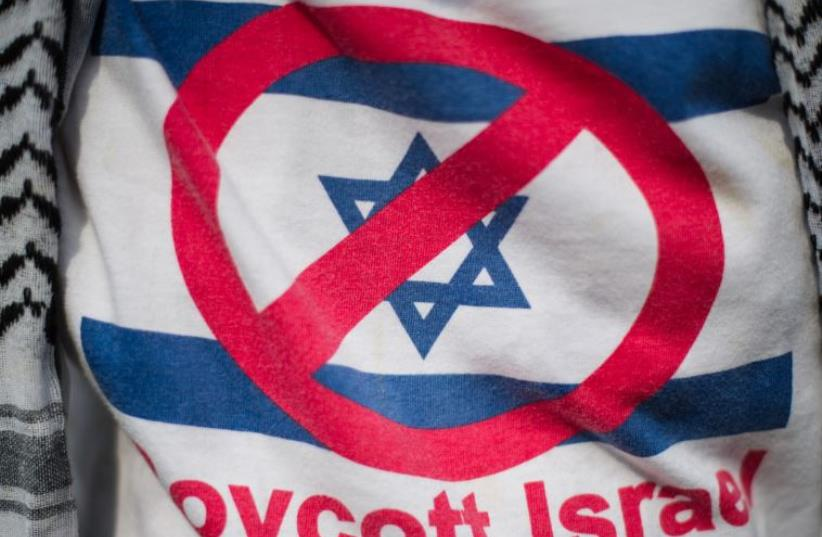 A demonstrator wears a shirt reading 'Boycott Israel' [File] (photo credit: AFP/ MOHD RASFAN)